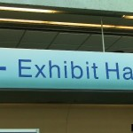 Exhibit hall sign held up with tape from thetapeworks.com